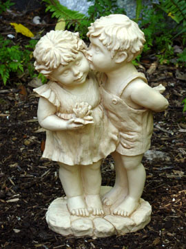 garden statue, boy and girl kissing